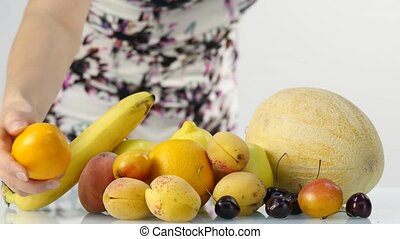 Slim young woman choosing fruits. Healthy eating. Weight...