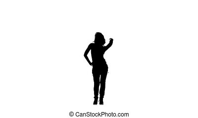 Slim, young woman dancer dancing sexy-jazz on white background, slow motion, silhouette