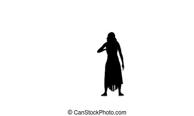 Slim, young woman dancer in long dress dancing on white background, slow motion, silhouette