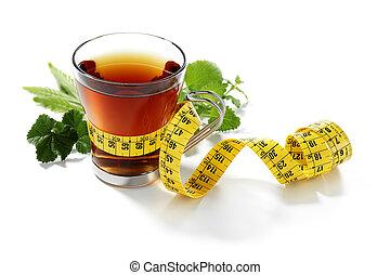 slimming herbal tea with measurement tape