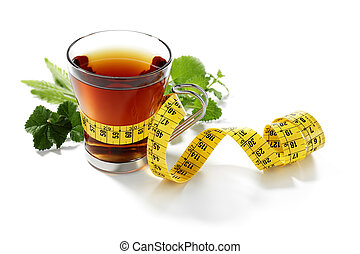 slimming herbal tea with measurement tape