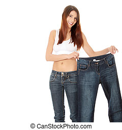 Slimming - Woman showing how much weight she lost. Isolated