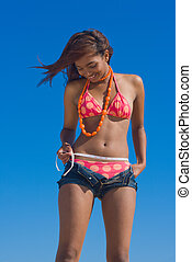 Slimming - Concept shot of a young girl on a diet measuring...