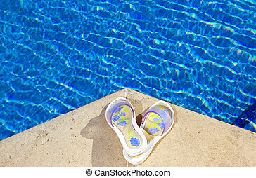 Slippers lies on the brink of pool