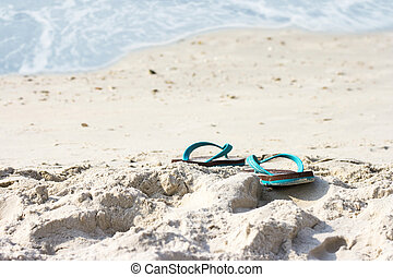 Slippers on the beach