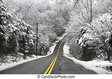 Hilly country roads, covered with black ice & snow