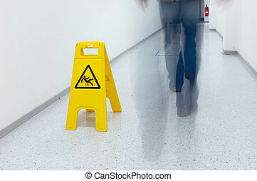 Slippery floor - Yellow warning sign for slippery floor in a...