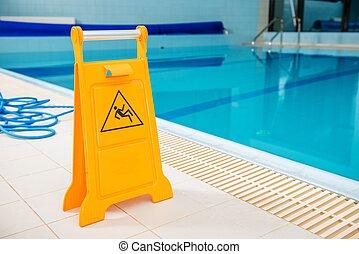 Slippery Swimming Pool Floor. Yellow Warning Sign.