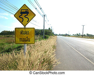 Slippery when wet sign warning in thailand