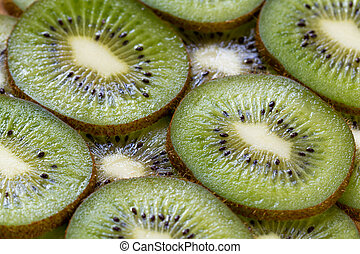 Slised kiwi fruits background close up
