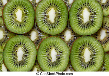 Slised pieces of kiwi background texture