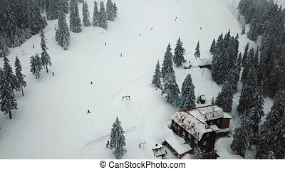 Slope for lowering skiers and snowboarders in the ski resort