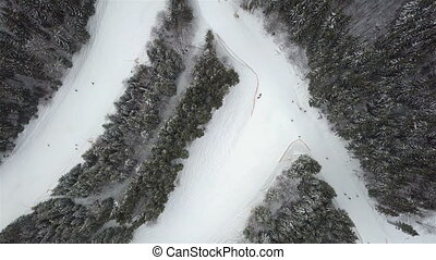 Slope for lowering skiers and snowboarders in the ski...
