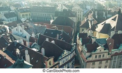 Sloped roofs and narrow streets of famous Old town in Prague, Czech Republic. 4K pan establishing shot