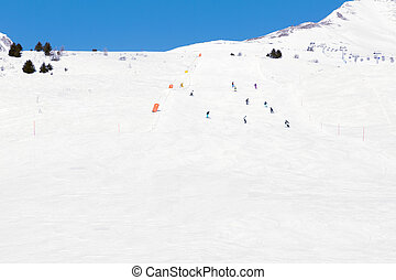 Slopes, lifts and skiers at ski resort in Italy, Alps