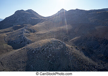 Slopes of a rocky mountains on a summer day.