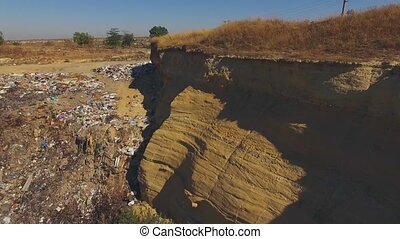 Slopes Of Quarry Littered With Garbage - AERIAL VIEW....