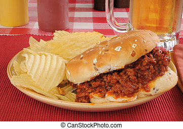 Sloppy Joe with beer - A sloppy joe with potato chips and a...