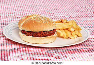 sloppy joe with french fries on checkered tablecloth