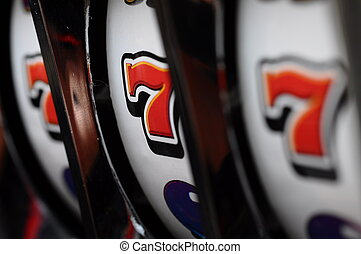 Slot machine and jackpot - Close up of three seven jackpot...