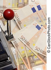 Slot machine and Lot of money fifty euros banknotes