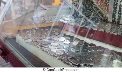 Slot machine in which the Georgian Tetri coins are located