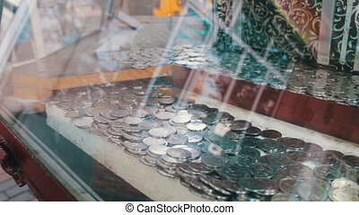 Slot machine in which the Georgian Tetri coins are located -...