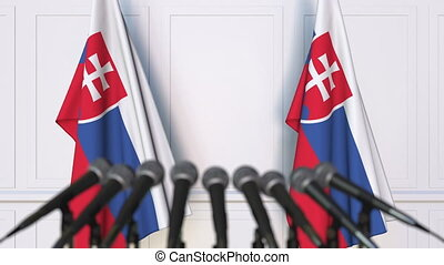 Slovak official press conference. Flags of Slovakia and...