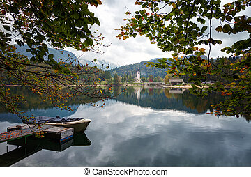 Slovenia, boat on Lake Bohinj, in the background the church...