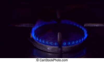 slow attenuation of gas power on the stove with its...