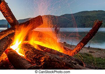 Slow burning fire at lake shore