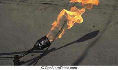 Slow burning gas burner