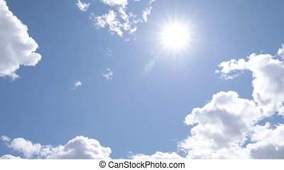 Slow camera movement cross sunny blue sky with white clouds, lens flare, 4k