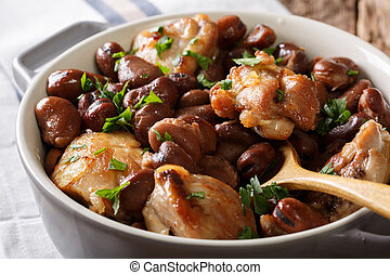 Slow cooked chicken with broad beans close up in a bowl. horizontal