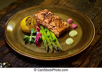 Slow Cooked Salmon fillet steak with salad on plate, Sous-Vide Cooking Salmon Fish