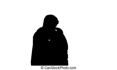 Isolated silhouette of a couple slow dancing
