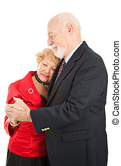 Slow Dancing - Senior couple doing a romantic slow dance....