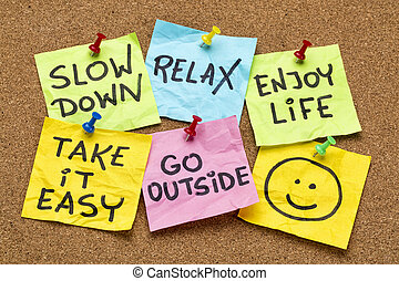 slow down, relax, take it easy, enjoy life - motivational lifestyle reminders on colorful sticky notes