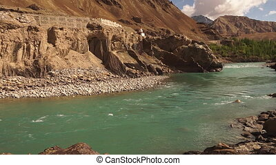Slow flowing water from Gangotri Glacier, India - A wide...