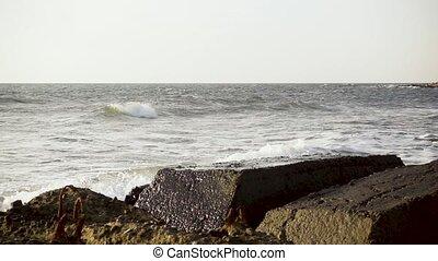 Slow mo broken about concrete reinforcement sea wave - Slow...