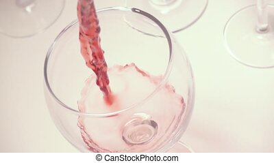 Slow mo red wine in a glass