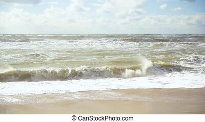 Slow mo storm in the sea and waves on the shore under the sun