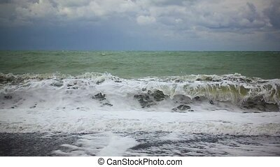 Slow mo the wave is gaining strength on the shore - Slow mo...