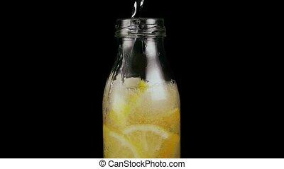 Slow mo. To make a lemonade in a bottle - Slow mo. Make a...