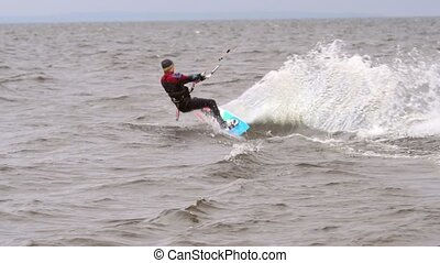 SLOW MOTION: A young man is engaged in kiting. He...
