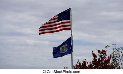 Slow Motion - American Flag Flies Over Maritime Flag in Wind...