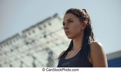 Slow motion: Athlete woman waiting in the starting block on ...