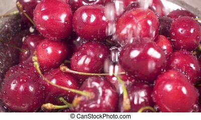 Slow motion cherry in colander under water - Slow motion...