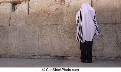 Slow motion clip of man pray at the Kotel