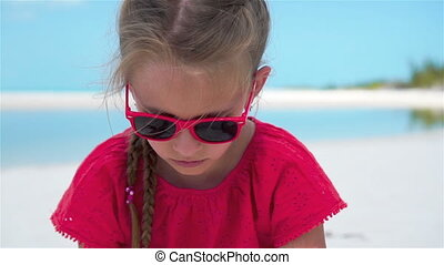 SLOW MOTION CLOSE UP: Girl playing with beautiful white sand at exotic beach
